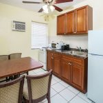 kitchenette and dining room in hotel room at Hollywood Beach Hotels