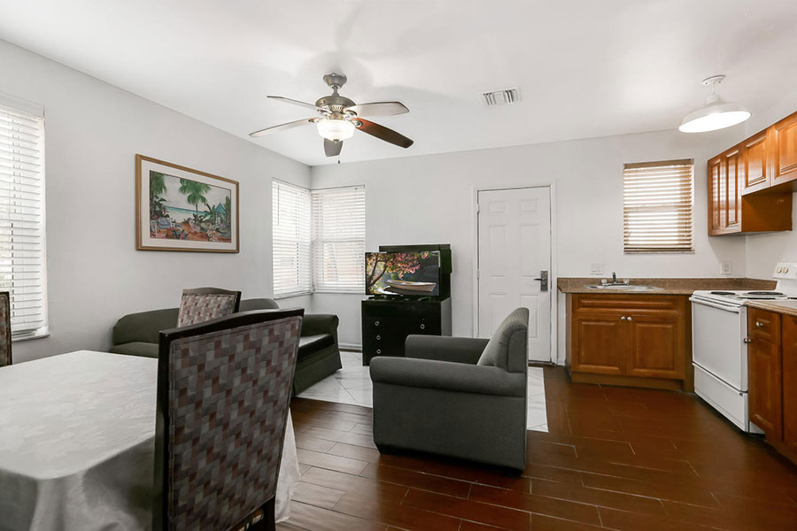 guest room living area and kitchen at Hollywood Beach Hotels
