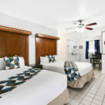 guest room with two beds and kitchen at Hollywood Beach Hotels