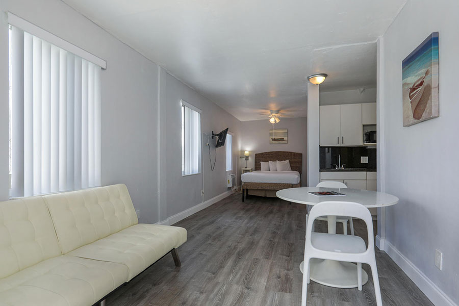guest suite with one bed, living area, and kitchen at at Hollywood Beach Hotels