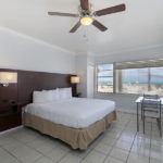 guest room with one bed and beach view at at Hollywood Beach Hotels