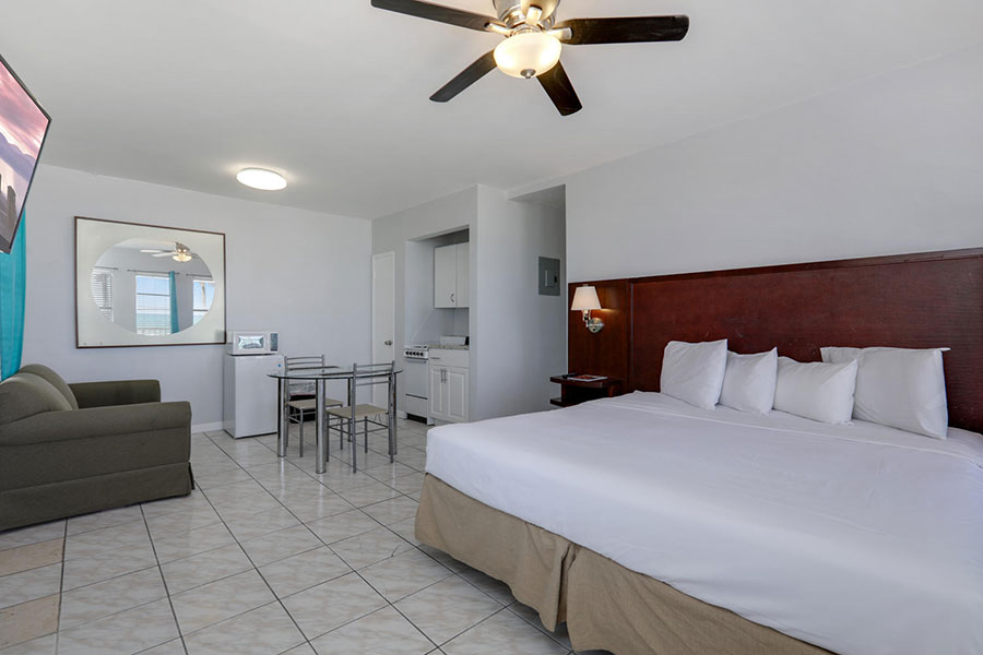 guest room with one bed, living area, and kitchenette at Hollywood Beach Hotels